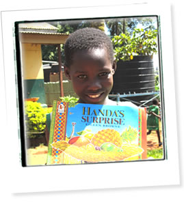 African schoolgirl reading Handas Surprise